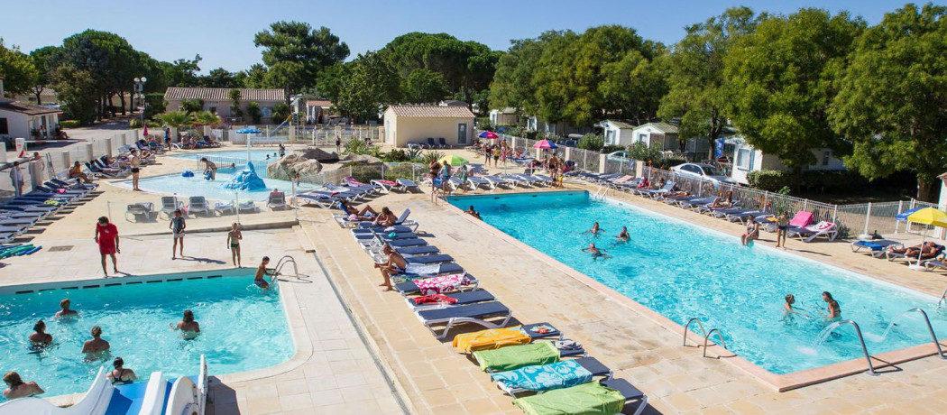 Rustige 4 sterren familiecamping met zwembad en waterpark in de Hérault tussen de Camargue en de Middellandse zee op 15 kilometer van de fijne zandstranden van Zuid-Frankrijk.