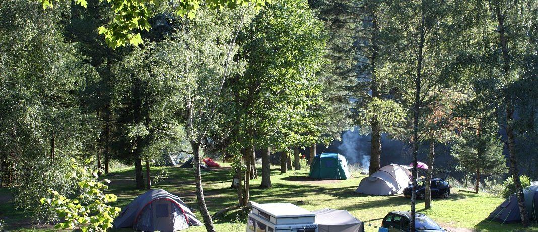 Camping Gademont Plage in Granges-sur-Vologne is een charme camping in het departement Vogezen gelegen aan een eigen zwemmeertje.